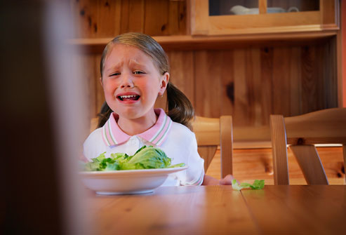 getty_rf_photo_of_girl_crying_over_bowl_of_veggies